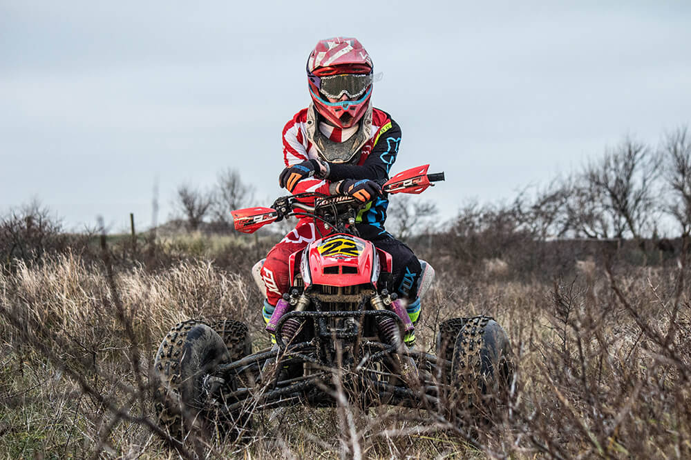 ATV trail rider sits on ride after a day out on the trails