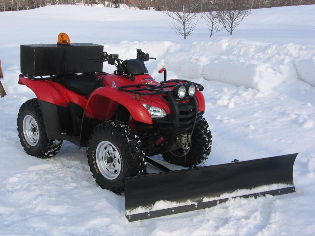 Honda ATV with snow plow attached
