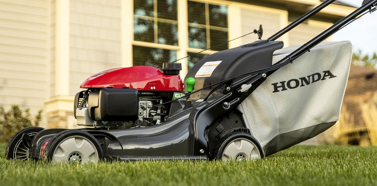 premium Honda lawnmower mowing grass