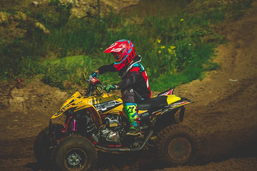 Child safely rides an ATV