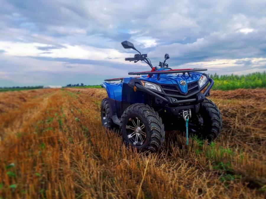 An ATV sits in an empty field